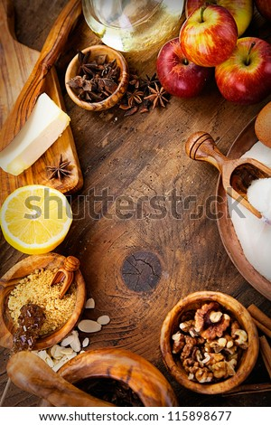 Baking concept background. Border design cooking,Christmas and winter  cookies ingredients.Baking pastry and cookies: apples, spices, sugar, eggs on wood - stock photo