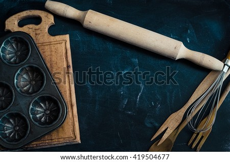 Baking concept on dark background. Baking preparation, top view of variety of baking utensils. Kitchen table ware rolling pin. Background layout with free text space. Top view. Copy space. - stock photo