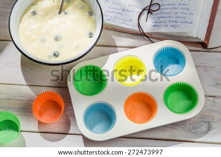 Baking delicious cupcakes with blueberries - stock photo