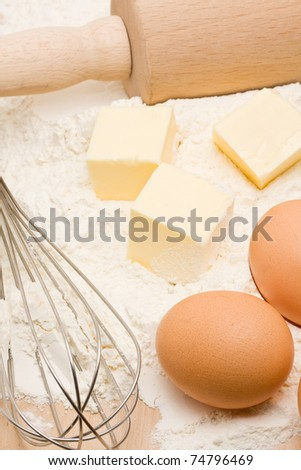 Baking ingredients and utensils on wooden table - stock photo