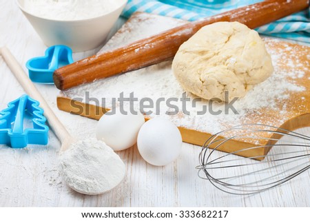 Baking ingredients on white wooden background. Top view - stock photo
