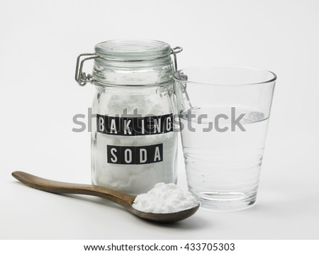 baking soda  and glass of water - stock photo