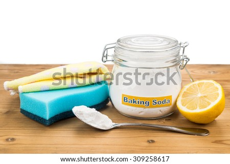 Baking soda, lemon with sponge and towel for effective and safe house cleaning - stock photo