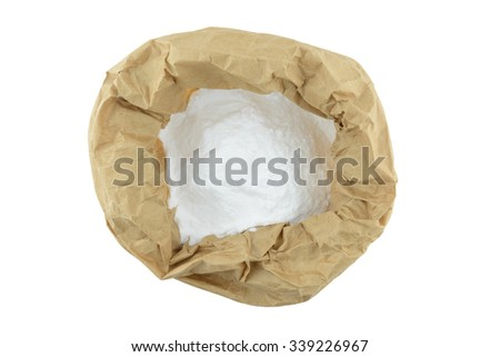 baking soda powder in brown paper bag, isolate background - stock photo