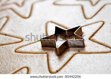 Baking star shape christmas cookies, selective focus - stock photo