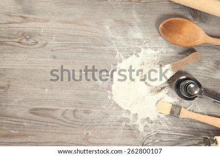 Baking tools from overhead view on wooden table in vintage tone, copy space on side. - stock photo