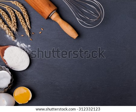 Baking tools on the black board, top view - stock photo