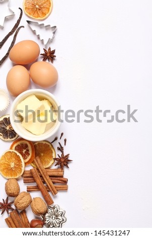 Baking utensils, spices and food ingredients on white background with copy space. - stock photo