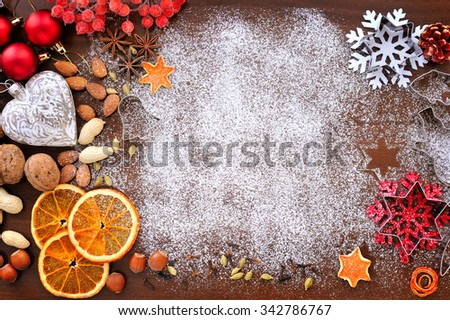 Baking utensils, spices and food ingredients on wooden background with copy space. Christmas holidays concept - stock photo