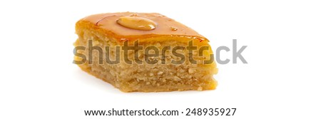 Baklava with almonds on white background. Macro with extremely shallow dof. Selective focus. - stock photo