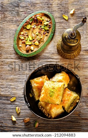baklava with pistachio. turkish traditional delight on a dark wood background. toning. selective focus on baklava - stock photo
