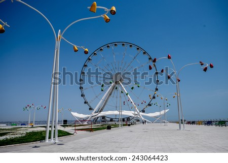 Baku ferris wheel (Baky eye) at the seafront park. - stock photo