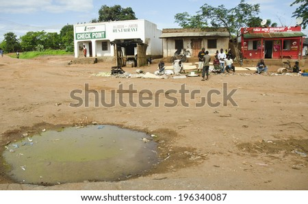 BALAKA, MALAWI - JANUARY 19: stagnant water on January 19, 2014 in Balaka, Malawi. Most of Malawi's 15 million people live in rural areas where water-related diseases and HIV/AIDS are widespread.  - stock photo