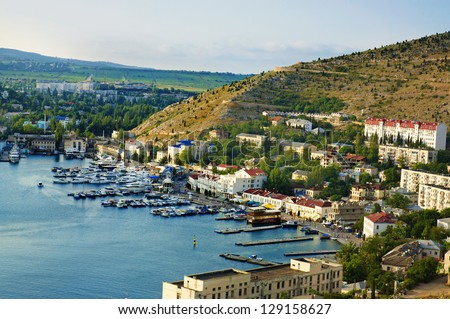 Balaklava city in Crimea, Ukraine, with sea bay and boats - stock photo