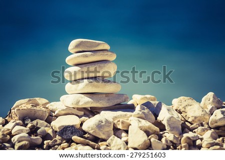 Balance and spa concept, inspiration, zen-like and well being tranquil composition. Wellness harmony, white stone pebbles stack over blue sea - stock photo