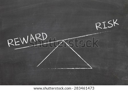 balance between risk and reward - stock photo