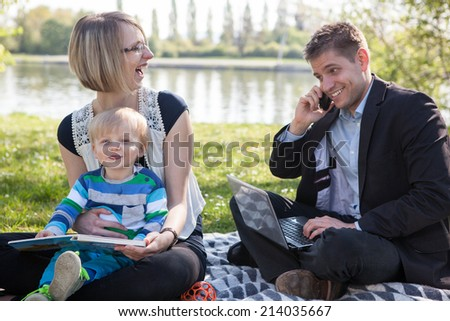 Balance between work and family life - stock photo