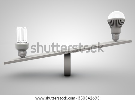 Balance Concept of two light bulbs - stock photo