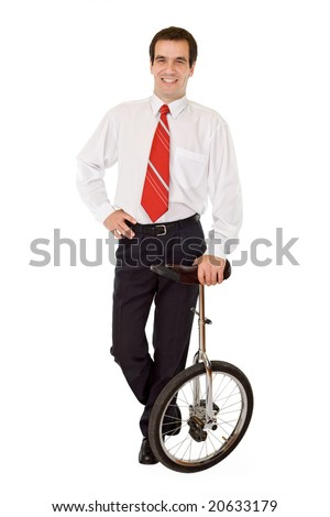 Balance in business concept - confident businessman with mono-cycle - isolated - stock photo