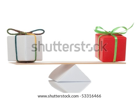 Balance of two present on white isolated background - stock photo