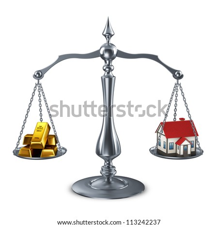 balance scale with house and goldbars - stock photo