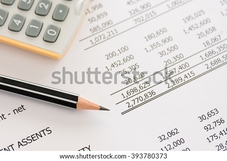 Balance sheet ,pencil, calculator on accountant's desk. Accounting , accounts concept. top view, above view. - stock photo