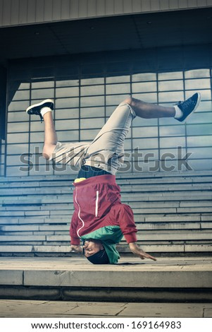 Balance stunt in an urban environment - stock photo