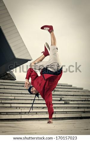 Balance stunt in an urban environment - stock photo