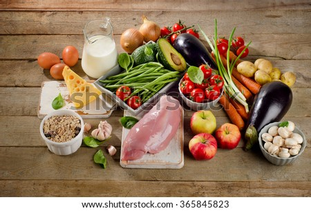 Balanced diet, cooking and healthy food concept on wooden table. View from above - stock photo