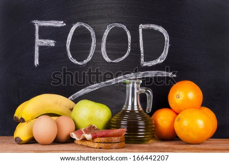 balanced diet products with blackboard - stock photo