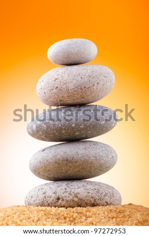 Balanced pebbles with colour background - stock photo