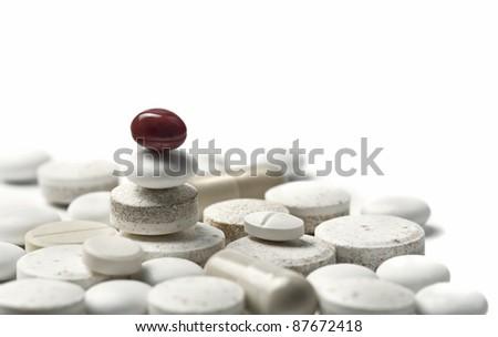 balanced pills metaphor of proper treatment - stock photo
