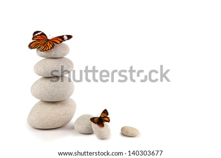 Balanced stones with butterfly - stock photo