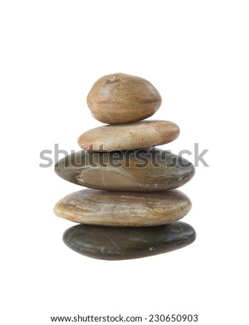 Balanced zen stones in pyramid isolated on white background. Harmony, healthcare and spa concept - stock photo