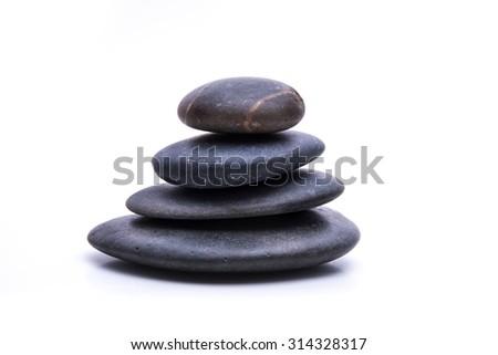 Balanced Zen stones on white background - stock photo