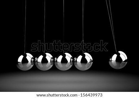 Balancing balls Newton's cradle - stock photo