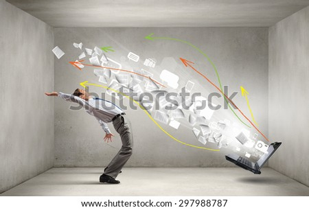 Balancing young man evading from explosion of ideas - stock photo