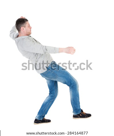 Balancing young man or dodge falling man. Rear view people collection.  backside view person. Isolated over white background. Man blows wind. Man swinging on his left leg and trying not to fall back. - stock photo