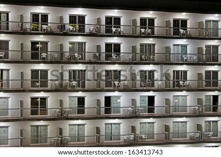 Balconies of modern hotel at night - stock photo