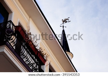 Balcony and tower with weather vane with griffin in Sukhumi, Abkhazia - stock photo