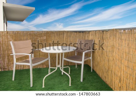 Balcony arrangement in a luxury apartment with blue sky in the background, Warsaw - stock photo