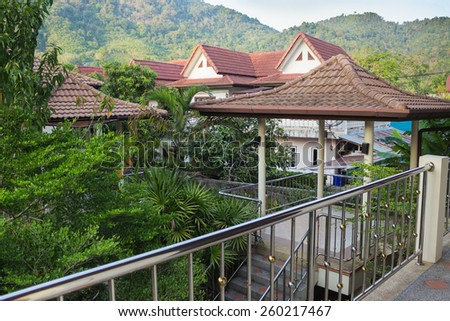 Balcony of a house overlooking the village and the jungle - stock photo