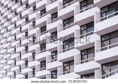 balcony of apartment building in city. - stock photo