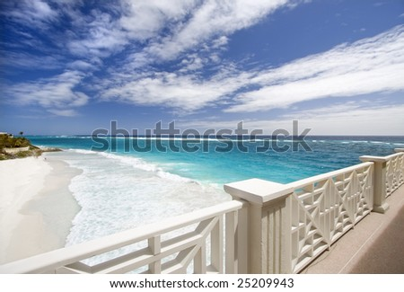Balcony overlooking empty beach, Barbados - stock photo