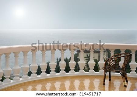 balcony / terrace on the sea during the rain / overcast - stock photo