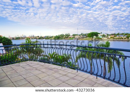 Balcony views from waterfront Mansion overlooking the canal - stock photo