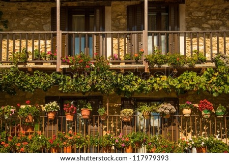 Balcony with many flower pots - stock photo