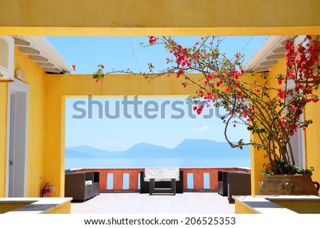 Balcony with sea view and bougainvillea flowers in bloom - stock photo
