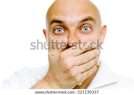 Bald blue eyes frightened man in a white jacket covers her mouth with his hand. Studio. isolated - stock photo