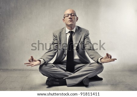 Bald businessman meditating - stock photo